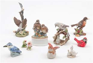 ELEVEN CHINA AND EARTHENWARE BIRD FIGURINES.