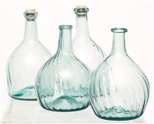 FOUR ZANESVILLE BLOWN GLASS BOTTLES.