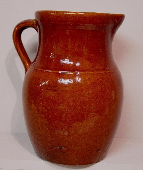 5: THREE ITEMS. Pottery pitcher with a medium