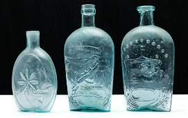THREE AMERICAN AQUA GLASS FLASKS.
