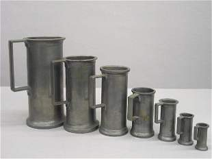 SEVEN GRADUATED PEWTER MEASURES. All are round with