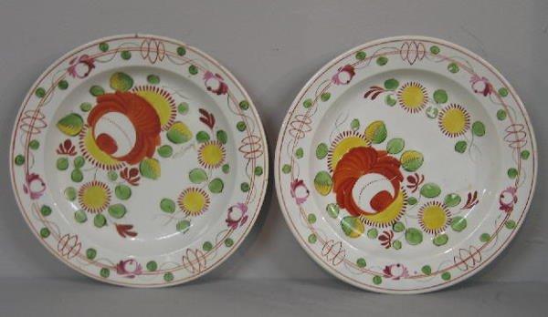 5: PAIR OF SOFT PASTE PLATES. Bright orange/red King's