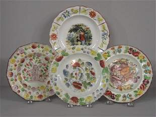 FOUR PLATES. All have embossed floral rims and hand