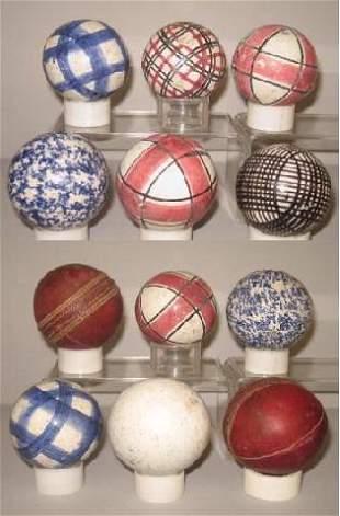 TWELVE BALLS. Ten are ladies' carpet balls. Four red