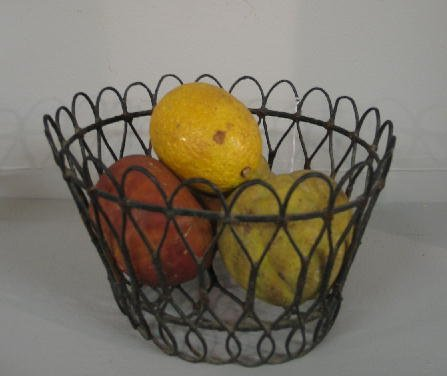 8: FOUR PIECES OF STONE FRUIT IN A WIRE BASKET. Red and
