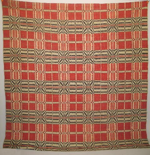 17: OVERSHOT COVERLET. Striking red and black on natura