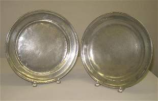 TWO PEWTER CHARGERS. One has stamped initials on th