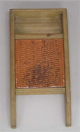 MINIATURE WASHBOARD. Poplar with a redware insert.