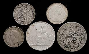 FIVE VARIOUS FOREIGN SILVER COINS