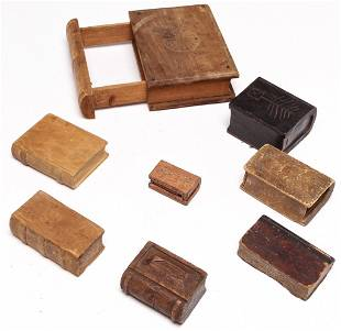 EIGHT AMERICAN CARVED WOODEN BOOKS.