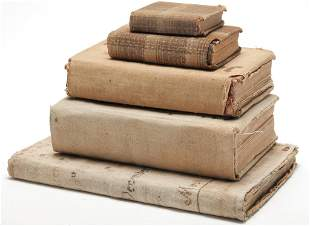 FIVE CLOTH COVERED BOOKS.