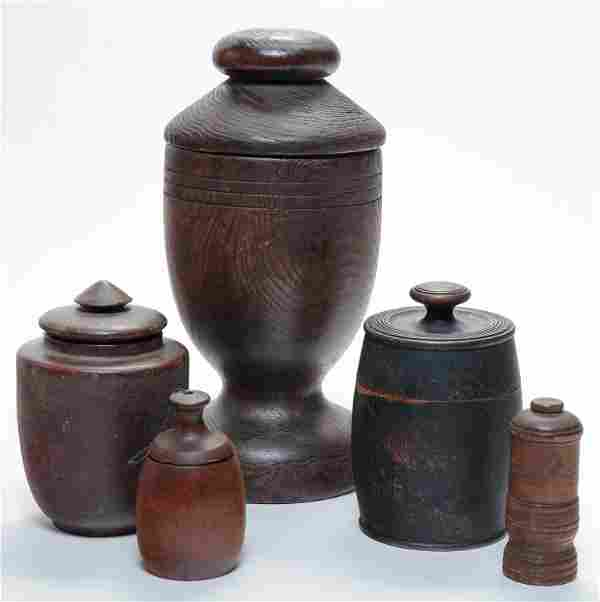 FIVE LIDDED TREENWARE CONTAINERS.