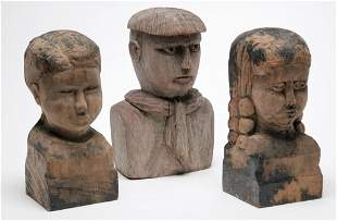 THREE CARVED FOLKSY BUSTS.