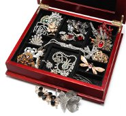 WOODEN BOX FILLED WITH CLASSIC COSTUME JEWELRY.