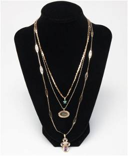 THREE YELLOW GOLD NECKLACES.