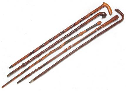 FIVE CARVED CANES.