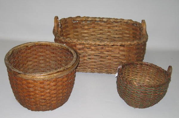 4: THREE WOVEN SPLINT BASKETS. All have high sides and
