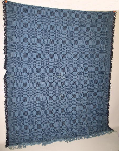 8: OVERSHOT COVERLET. Two-piece with an optical pattern