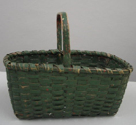 12: PAINTED BASKET. Woven splint with a bentwood handle