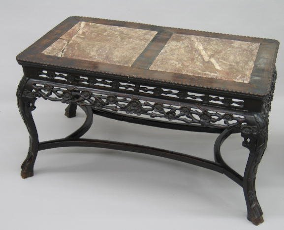 22: CHINESE CARVED COFFEE TABLE. Teakwood with a dark f