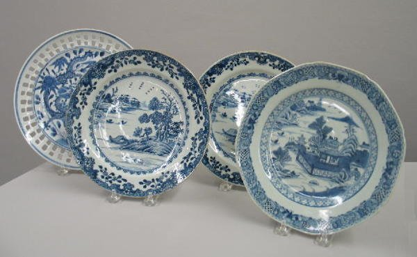 23: FOUR BLUE AND WHITE ORIENTAL PLATES. One with a pal