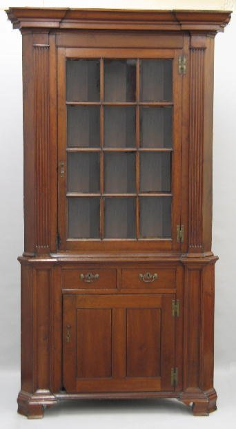 421: CHIPPENDALE TWO-PIECE CORNER CUPBOARD. Attributed