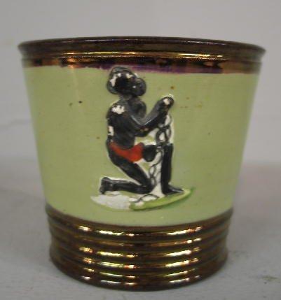 427: COPPER LUSTER TUMBLER. Unusual applied relief figu