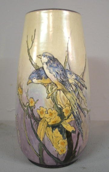428: ART POTTERY VASE. Hand painted long tailed blue bi