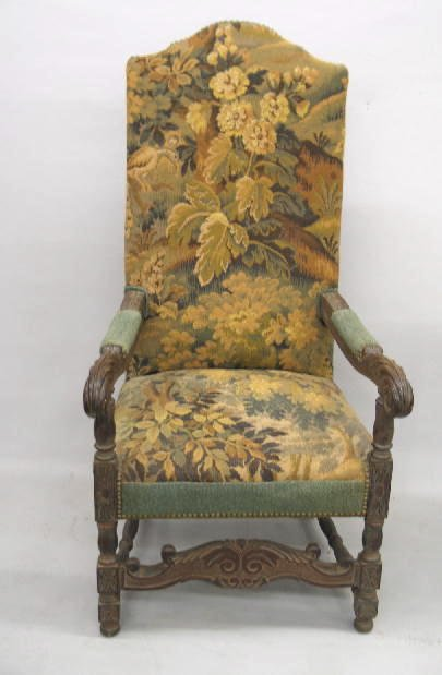 441: FLEMISH STYLE CARVED ARMCHAIR. Walnut. Turned post