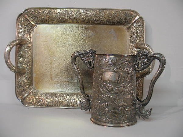 477: TWO PIECES OF ORIENTAL SILVER. Tankard mug with dr