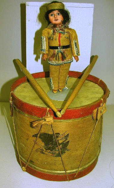 """2: SCOWLING INDIAN  DOLL, 8"""" AND TOY DRUM, 8""""H, 9 1/2""""W"""