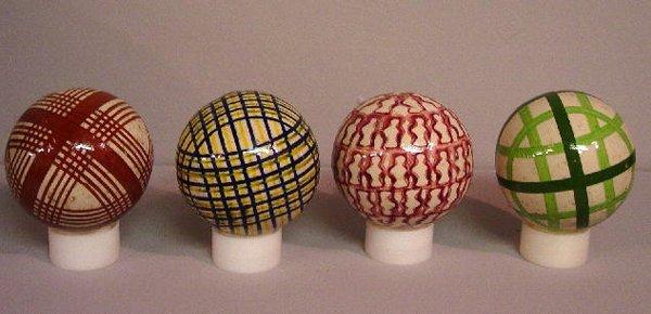 3: FOUR MEN'S CARPET BALLS. Red stamp; light