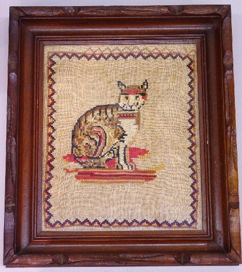 10: TWO FRAMED EMBROIDERIES OF CATS. The larg