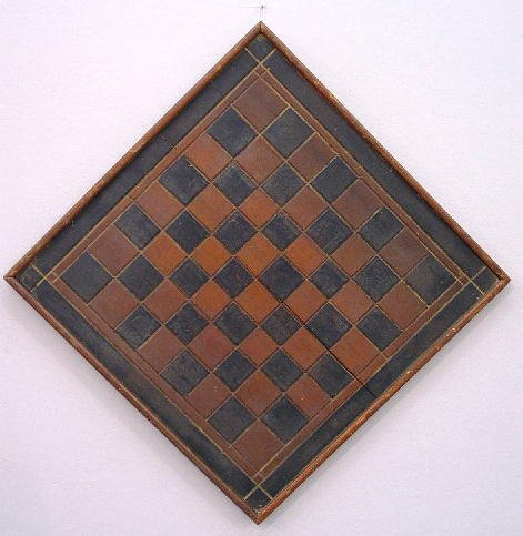 12: GAME BOARD. Incised carved borders and di