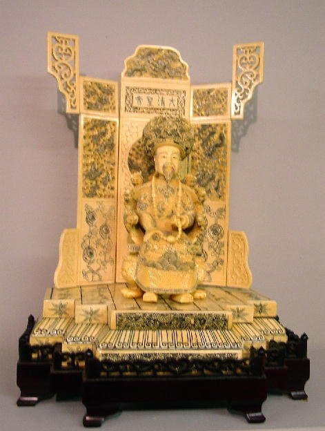 22: PAIR OF LARGE IVORY CARVINGS OF A CHINESE