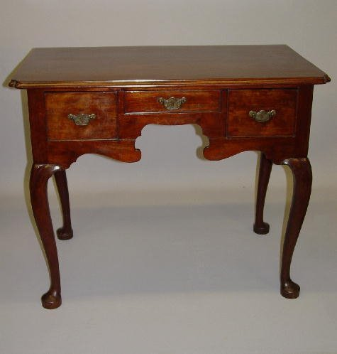 28: ENGLISH QUEEN ANNE LOWBOY. Walnut with an
