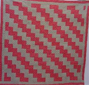 414: PIECED QUILT. Red and grey calico zigzag