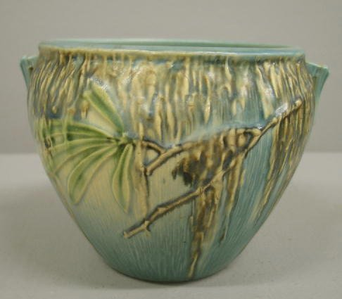 1003: ROSEVILLE MOSS HANDLED BOWL. Ivory to blue glaze.