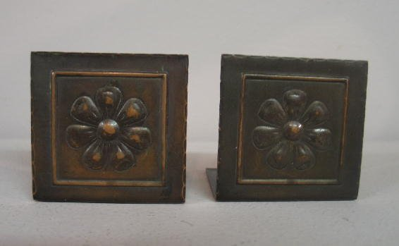 1009: PAIR SMALL ARTS & CRAFTS COPPER BOOKENDS. Embosse