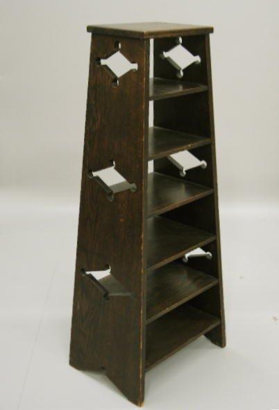 1012: ARTS & CRAFTS BOOKCASE. Oak with dark stain. Tape