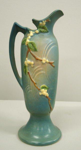 1013: ROSEVILLE SNOWBERRY EWER. Blue glaze. Relief mark