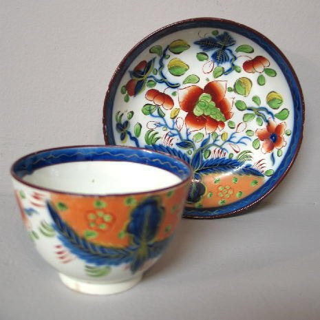5: GAUDY DUTCH HANDLELESS CUP AND SAUCER. Dove pattern