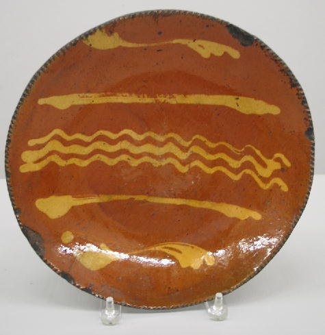 11: REDWARE CHARGER. Coggled edge with yellow slip line