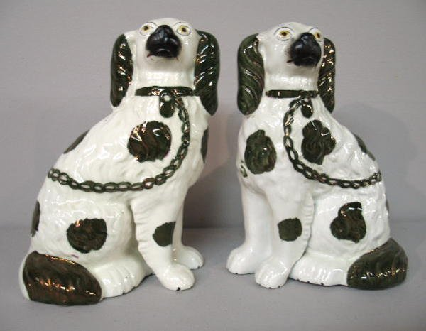 14: PAIR OF STAFFORDSHIRE DOGS. Seated spaniels with co