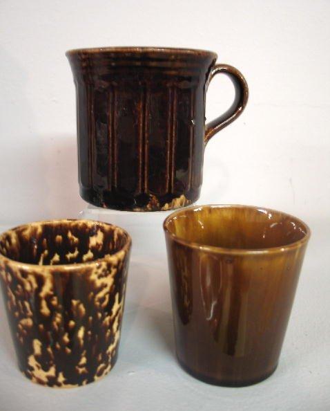 "437: THREE ROCKINGHAM CUPS. Two tumblers, 2 /78"", 3 1/4"