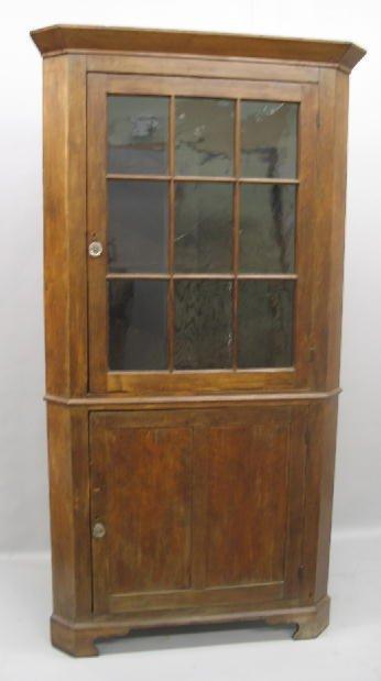 438: COUNTRY CORNER CUPBOARD. One-piece cherry cupboard