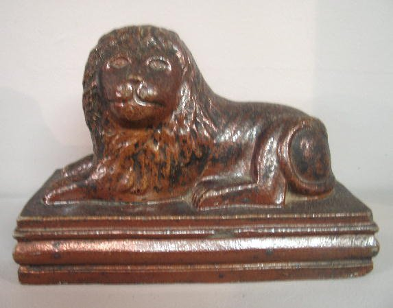 445: SEWERTILE LION. Reclining molded lion on a rectang