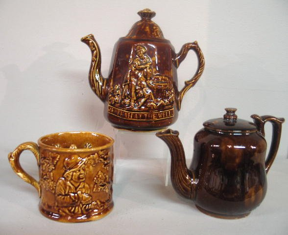 446: THREE PIECES OF ROCKINGHAM. Pictured is a mug with