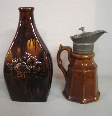 447: TWO PIECES OF ROCKINGHAM. Pictured is a flask with