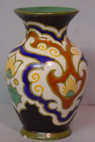 "4: TWO PIECES OF ""GOUDA"" POTTERY. Vase in ivo"